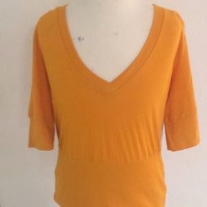 Anthropology orange shirt. Large new with tags.